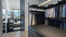 Victory Park High-Rise: Walk-in closet using Rimadesio Dress Bold and Self with Rimadesio Sail sliding glass door as partition from master bedroom.