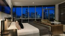 Master bedroom at dusk with view of downtown Dallas.